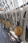 stock photo of shekel  - Closeup of many tightropes and shekels of a sailing ship or yacht - JPG