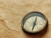 compass on the background of an old paper