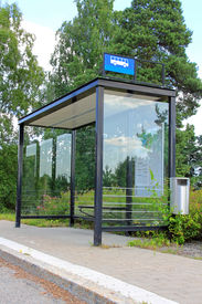 stock photo of bus-shelter  - Urban bus stop shelter space for your advertisement - JPG