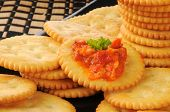 stock photo of piquillo pepper  - Golden wheat crackers with bruschetta and a sprig of parsley - JPG