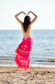 image of braless  - girl doing at the beach - JPG