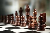 pic of battlefield  - Chess board with chess pieces on dark background - JPG