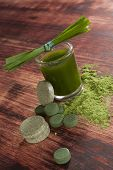 foto of chlorella  - Green drink with green pills and ground powder - JPG
