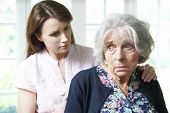 picture of bereavement  - Adult Daughter Consoling Senior Mother At Home - JPG