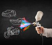 stock photo of airbrush  - Man with airbrush spray paint with car - JPG
