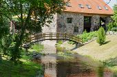 picture of manor  - park landscape with wooden bridge over stream and ancient architectural brick manor - JPG