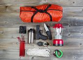 picture of pistol  - Overhead view of hiking gear and personal protection pistol and knife placed on rustic wood - JPG