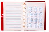 stock photo of 70-year-old  - Open Blank Page Russian Notebook With Calendar 1977 year - JPG