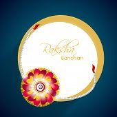 picture of rakhi  - Beautiful rakhi with golden circle frame on blue background for Happy Raksha Bandhan celebrations - JPG