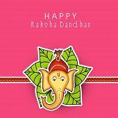 stock photo of rakhi  - Beautiful rakhi decorated with Hindu mythology Lord Ganesha with mango leaves on pink background for Happy Raksha Bandhan - JPG