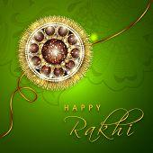 image of rakhi  - Beautiful rakhi on floral decorated green background for Happy Raksha Bandhan celebrations - JPG