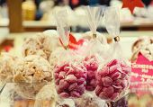 stock photo of sweetie  - Sacks of candy on form heart Christmas sweeties - JPG