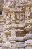 picture of kama  - Sculptures of loving couples illustrating the Kama Sutra on walls of Lakshmana Temple at Khajuraho in India Asia - JPG