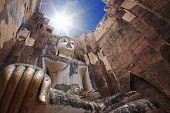 image of chums  - Big buddha against sunbeam at wat Srichum or Sri Chum - JPG
