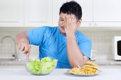stock photo of junk  - Starting healthy eating - JPG