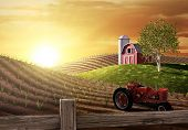 image of red barn  - Red barn and tractor on a farm with the sun rising over the horizon - JPG