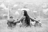 stock photo of children walking  - Happy mother with small children walking in autumn ( black and white )