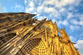 stock photo of dom  - Facade of the Dom church in the city Cologne with blue sky and evening sun - JPG