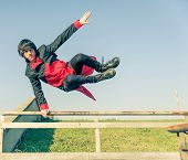 image of parkour  - Parkour athlete jumping over a handrail  - JPG
