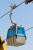 picture of leaving  - View of a cableway cabin leaving the station - JPG