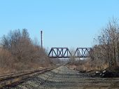 image of trestle bridge  - a train trestle that goes over another set of railroad tracks - JPG