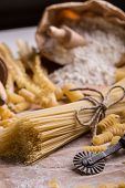 stock photo of bundle  - Bundle of uncooked italian spaghetti, studio shot
