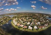 pic of suburban city  - Suburban waterfront homes in Florida aerial view - JPG