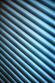 stock photo of jalousie  - Metal jalousie background in blue toning in closeup - JPG