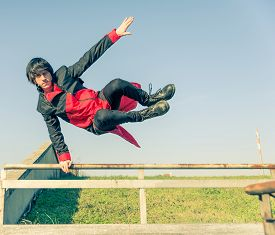 picture of parkour  - Parkour athlete jumping over a handrail  - JPG