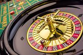 stock photo of roulette table  - the cylinder of a roulette gambling in a casino - JPG