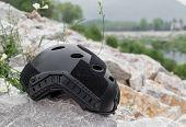 foto of special forces  - Special force Modern combat helmet on white rocks at riverside - JPG