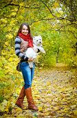 image of west highland white terrier  - woman with west highland terrier in the park - JPG