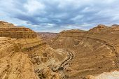image of ravines  - view of ravine from a height in the desert - JPG