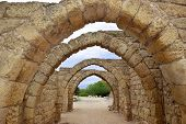 stock photo of crusader  - remains of the archs over the main streets of the ancient city of Caesarea - JPG