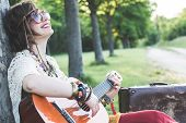 picture of hippy  - Hippie woman playing guitar - JPG