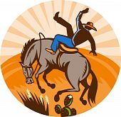 stock photo of bucking bronco  - illustration of a cowboy falling off horse in the desert done in retro woodcut style - JPG