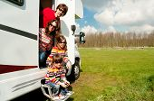 stock photo of camper  - Family vacation, RV (camper) travel with kids, happy parents with children on holiday trip in motorhome