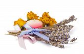 stock photo of bunch roses  - Spa Accessories two bunches of lavender with ribbon drided roses and a candle isolated on white  - JPG