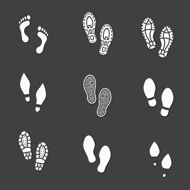 stock photo of footprint  - Set of footprints and shoeprints icons showing bare feet  in white showing bare feet and the imprint of the soles with the differing patterns of male and female footwear with shoes  boots and high heels - JPG