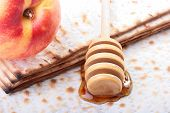 stock photo of sukkoth  - Honey with a special spoon matzah and nectarine - JPG
