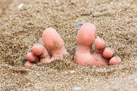 pic of wet feet  - toes buried in the sand of the sea on the beach foot on the sand summer theme - JPG