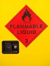 stock photo of liquid  - Flammable liquid cabinet door with warning sign and lock - JPG
