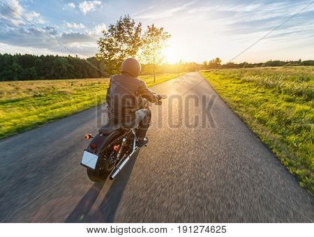 Dark motor biker riding high