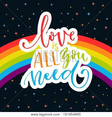 Love is all you need. Words on rainbow parade flag at dark sky with stars. Gay pride saying for stickers, t-shirts and posters