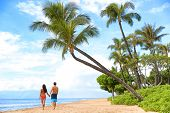 Постер, плакат: Hawaii beach vacation couple walking people lifestyle Kaanapali beach Maui Hawaii USA Two per
