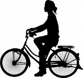 silhouette of woman on bicycle