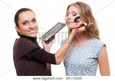 poster of professional esthetician applying eyeshadow from color palette. isolated on white background
