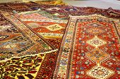Persian Carpets In Yazd, Iran. Carpet Weaving Is An Essential Part Of Persian Culture And Iranian Ar poster