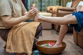 ํyoung Woman Having Feet Massage In Beauty Salon, Pedicure And Foot Massage, Woman In A Beauty Salon poster