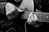 Guitarist Hands And Guitar Close Up. Playing Electric Guitar. Play The Guitar. Black And White. poster